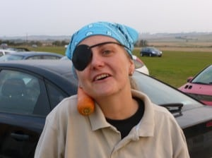 A confused trainee-pirate at the car boot sale with a carrot on her shoulder!
